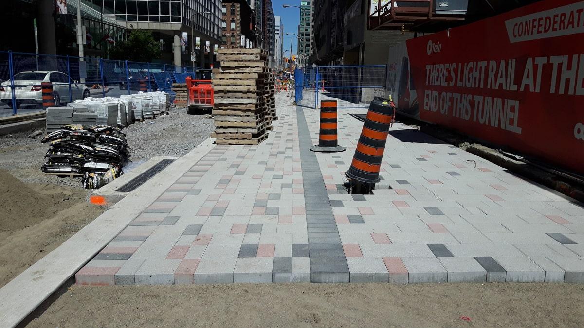 Precast concrete paver installation on Queen Street