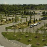 Brookstreet Hotel parking lot with tree planting and plant beds