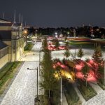 Lansdowne Park at night with precast concrete pavers, plant beds, and site lighting