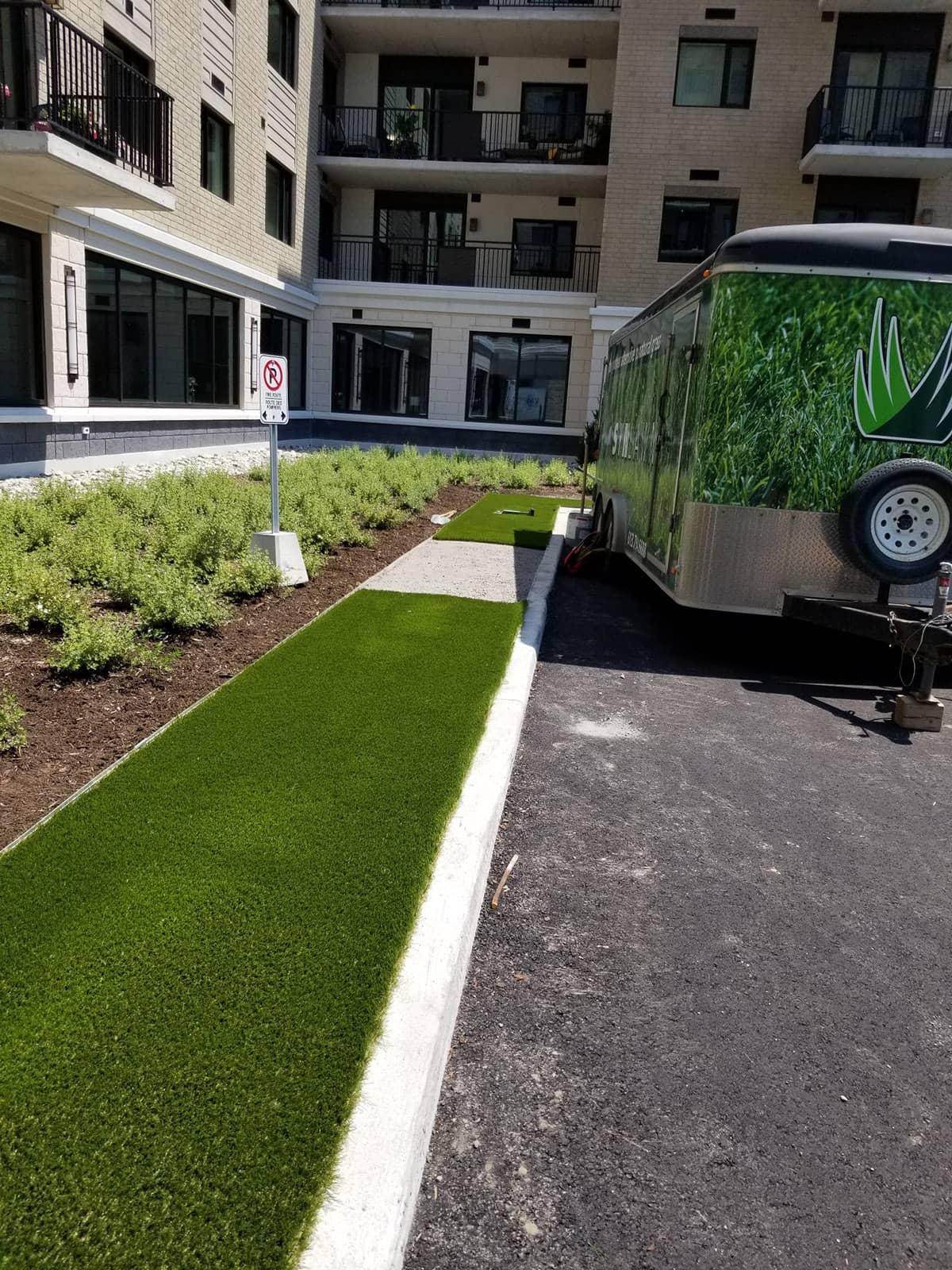 Plant beds and artificial turf at Les Terasses Francesca Apartment Community