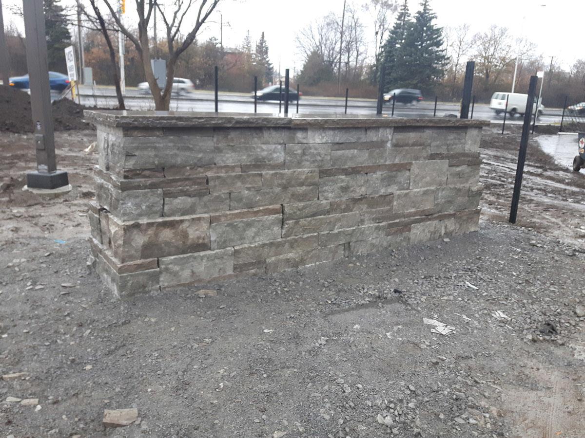 Stone wall at Les Terrasses Francesca Apartment Community