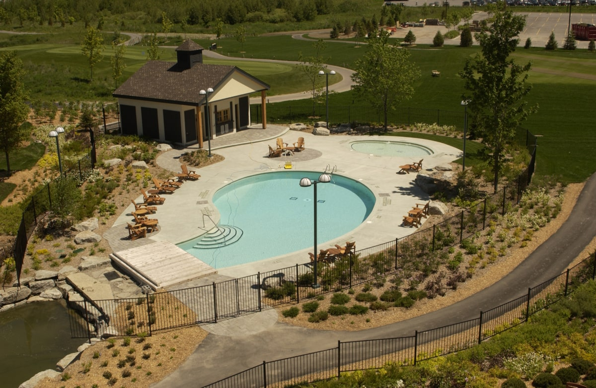 Outdoor pool and surrounding landscaping at Brookstreet Hotel