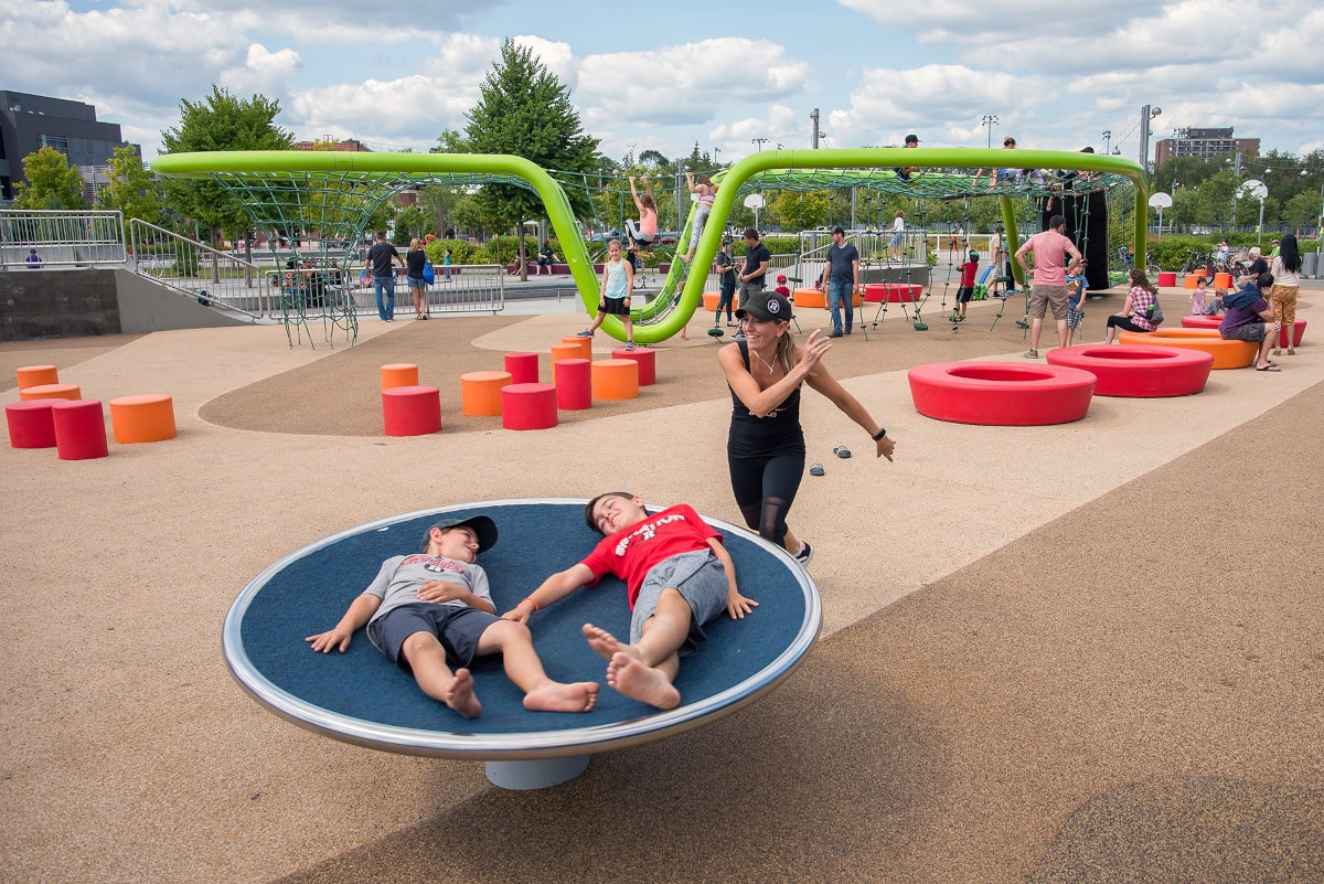Lansdowne Urban Park play area in use with large and small play structures