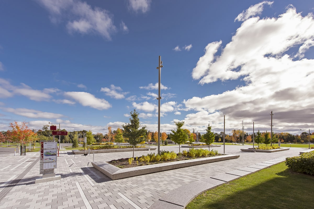 Lansdowne Urban Park porch with concrete planters, granite seating, and plant beds