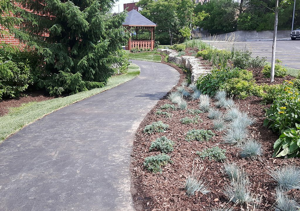 Asphalt path and plant beds at Grace Manor